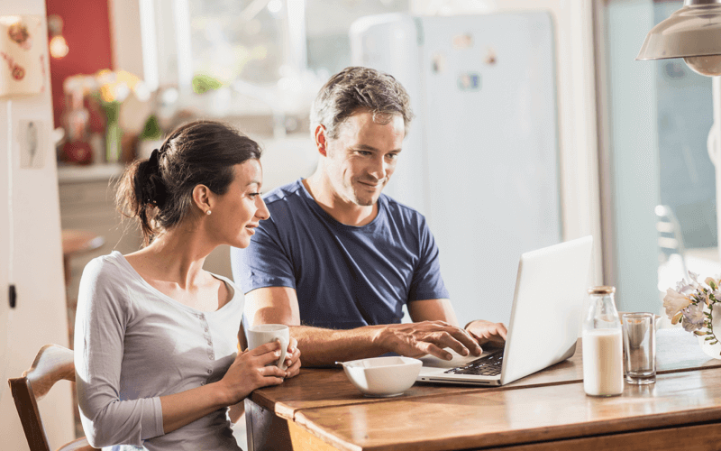 Two people reviewing their finances